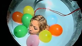 Held up by balloons to avoid sinking in water