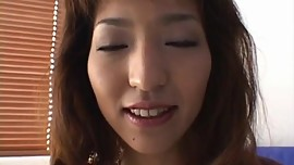 Kyoko Izumi pretty Asian milf with long nails gets exposed pussy vibrated