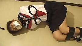 Japanese School Girl with Leather Bondage
