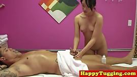 Petite asian masseuse rubs clients cock